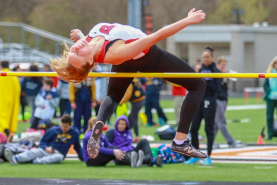 Pinckney's Nicole Burcon won the high jump by clearing 5 feet at the SEC White track and field meet.