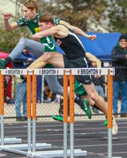 Pinckney's Dylan Deck (foreground) swept the hurdles in the SEC White meet.