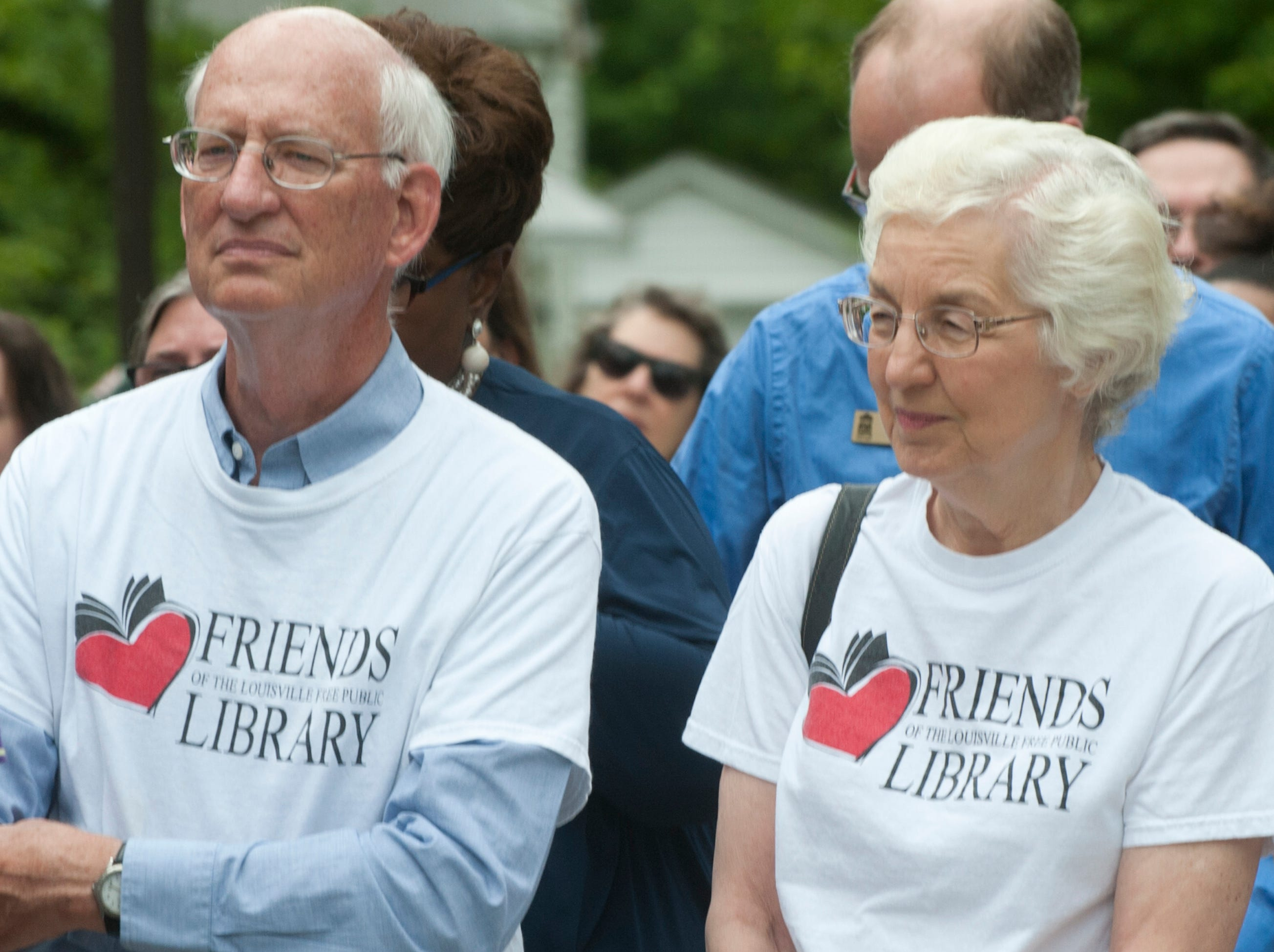 St. Matthew Friends of the Libarary President Gary Luhn and his wife, Jeanne, listen to speakers at the grand reopening of the library. May 9, 2019