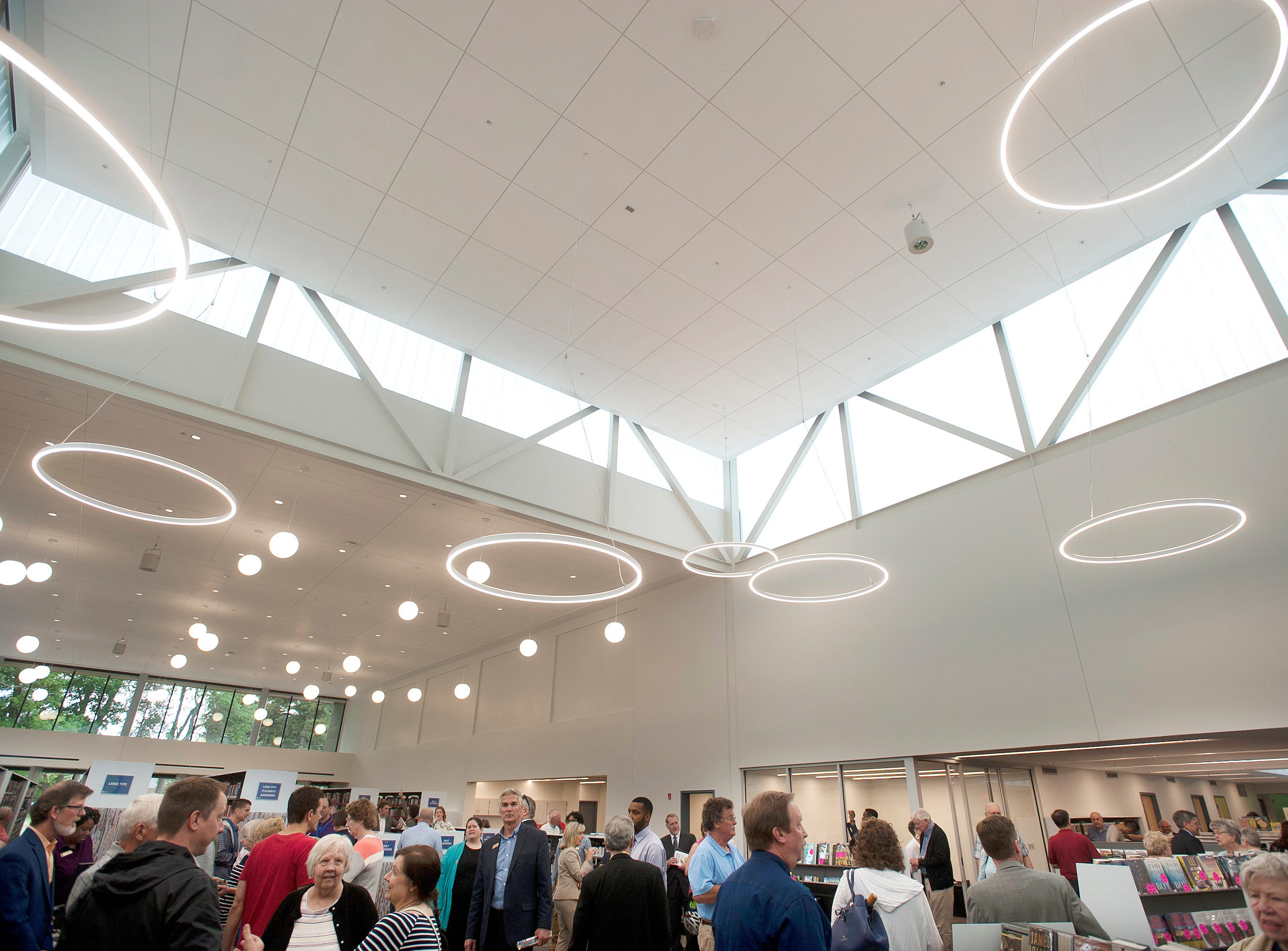 Patrons crowd into the newly constructed addition to the St. Matthews Eline Library during the library's grand-reopening.  It had been closed for the past 251 days. May 9, 2019
