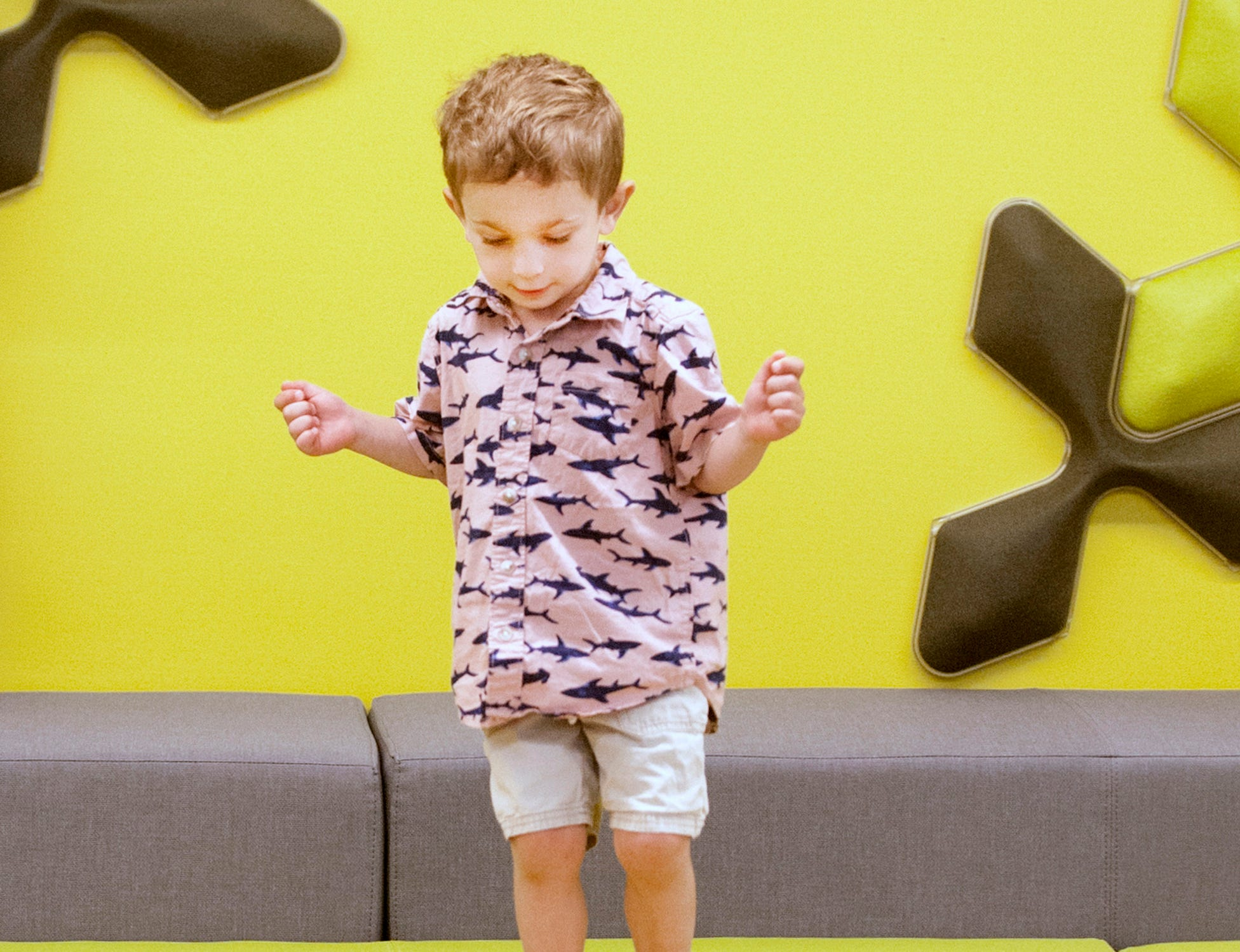 "Benjamin Jackson, age 3, of Indian Hills, jumps on a cushion in the children's ""read to me"" room. May 9, 2019"