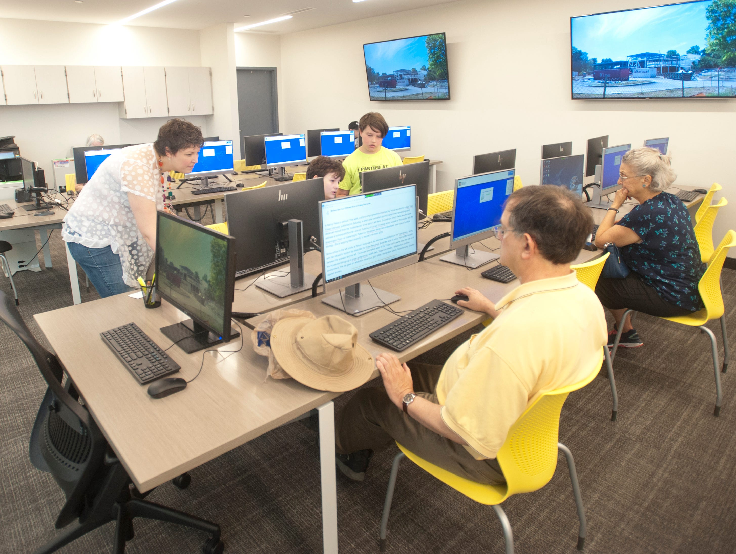 Patrons use the computer area of the library. May 9, 2019
