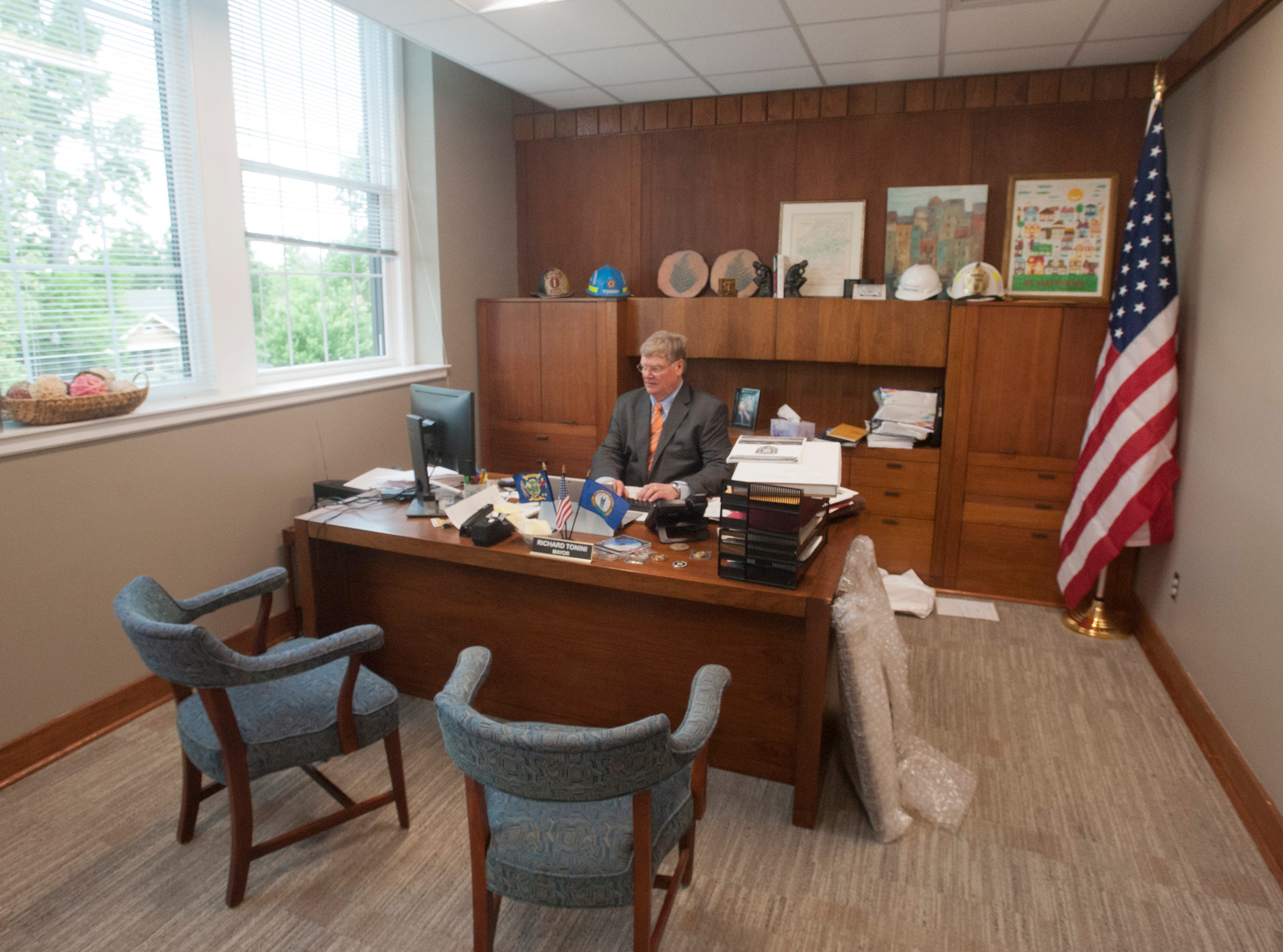 St. Matthews Mayor Rick Tonini works at his desk, in the former office of the Future Federal Savings and Loan president's office. May 9, 2019