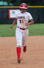 Manual's Jeanay Riley (21) heads towards third base after hitting a homerun against  Assumption at Manual High School.  Assumption won 13-12. May 9, 2019
