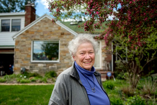 Eve Brown, 77, photographed on Friday, May 10, 2019, outside her Sycamore Park home in Lansing, lives in what is currently classified as the Red Cedar flood plain. Brown is hopeful her property could leave the flood zone if an updated map is created.