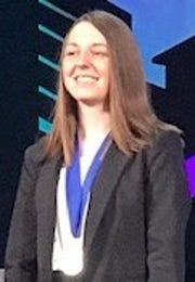 Kailey Smidel wearing the medal she received after being announced as a Distinguished Chapter Officer at Phi Theta Kappa's annual convention.