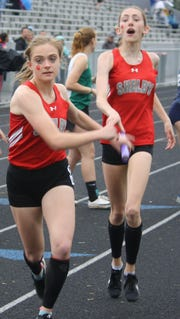 Shelby anchor Makenna Heimlich takes the baton from Reyna Hoffman and the Whippets go on to win the 4x400 at the MOAC meet.