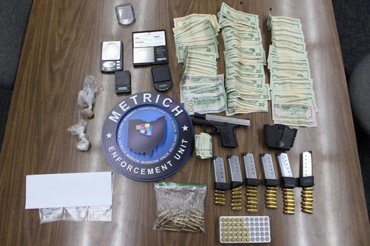 The METRICH Enforcement Unit seized suspected heroin and fentanyl, a firearm and $4,761 in cash Friday during a search on East First Street.