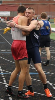 Quadruple winner Colbey Fox of Galion embraces reigning indoor state 800 meters champ Blake Lucius of Shelby after their duel in the 400 at Thursday's Mid-Ohio Athletic Conference track and field meet at Marion Harding.