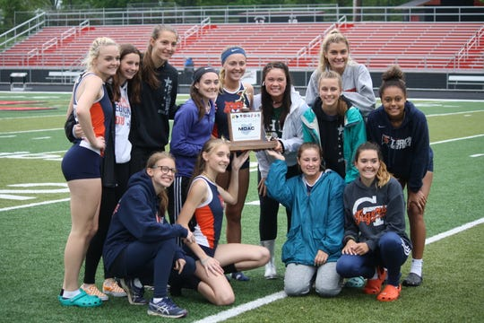 The Galion girls, led by quadruple winner Kerrigan Myers (standing, third from left), repeated as MOAC champs.