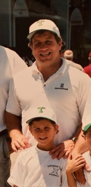 Colton Neel, below, with his father, Mark Neel, who died in 2007.