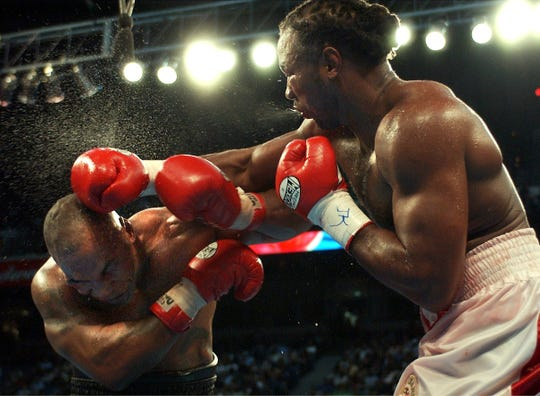 Lennox Lewis lands a right against Mike Tyson at The Pyramid in 2002.