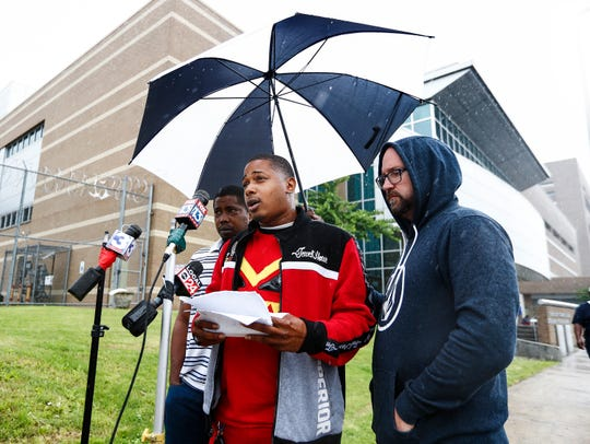Jamarious Banks (middle), brother of shooting victim Martavious Banks, along with local activists, hold a press conference in the rain outside of 201 Poplar Ave. on Friday afternoon in Memphis, Tenn. According to a statement released earlier in the day by the Shelby County District Attorney's office, the four Memphis Police Department officers involved in the shooting of Banks on Sept. 17, 2018, will not be charged. On Thursday, Banks was indicted on several charges tied to that September incident.