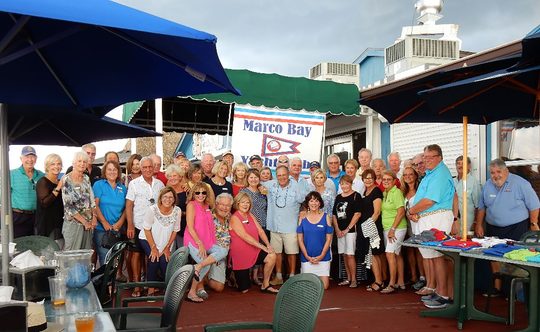 """If it's the last Monday of the month, then it's time for some madness. Each month, on the last Monday of the month, the Marco Bay Yacht Club gathers for Monday Madness! It's a great opportunity to meet with any of our 180-plus members and share experiences. Hours are 4:30 until 6:30 p.m., although many usually stay for dinner. Members take advantage of our Ship's Store, which often features deep discounts on some items. Our normal location is our official """"Home"""": CJ's on the Bay at the Esplanade, however this latest Monday Madness was at the """"new"""" Old Marco Lodge, newly named """"Paradise Found"""" by their new Owner, Jim Paradise. Located in Goodland with ample dock slips, this Goodland tradition has really come back to life with a new menu, chef, 'spruced-up' amenities, and a great new menu."""