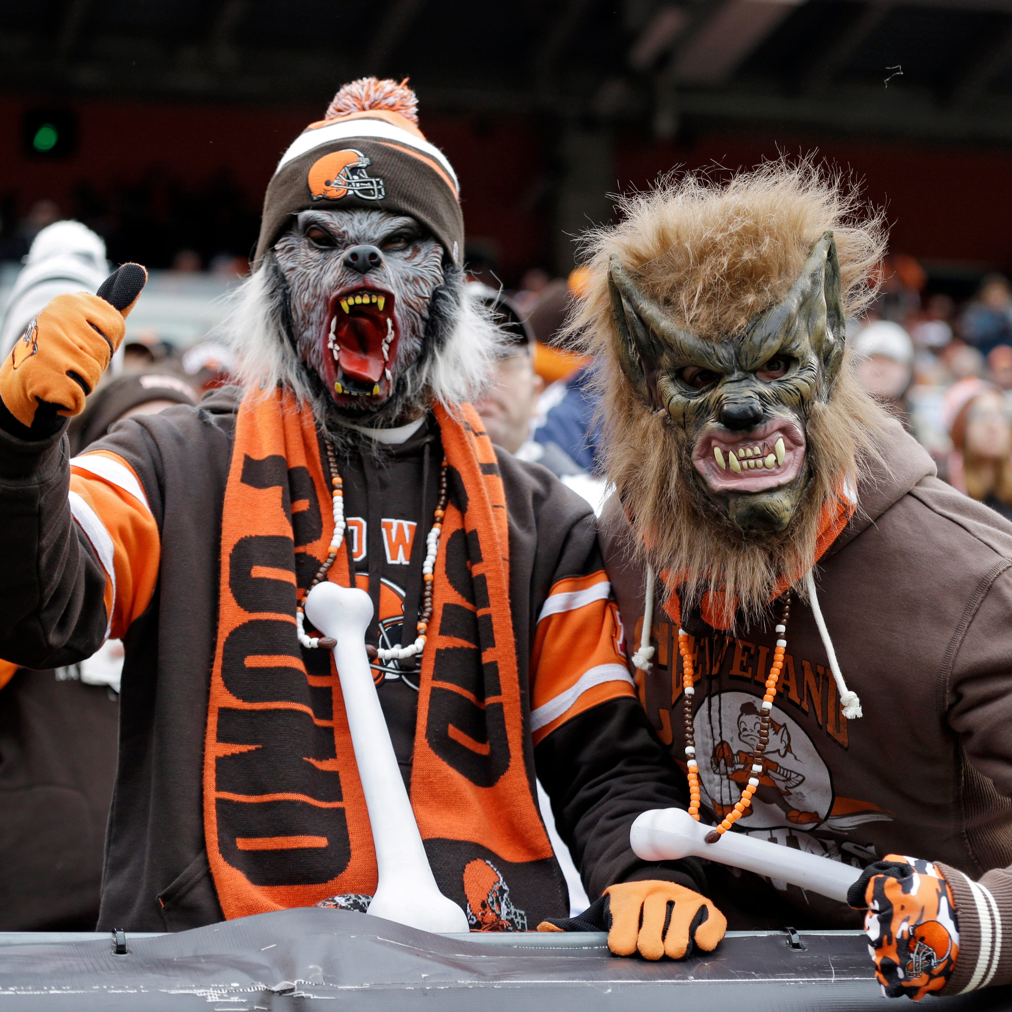 Cleveland Browns fans in the Dawg Pound cheer as their team prepares to kick off against the Jacksonville Jaguars in an NFL game Sunday, Dec. 1, 2013, in Cleveland.