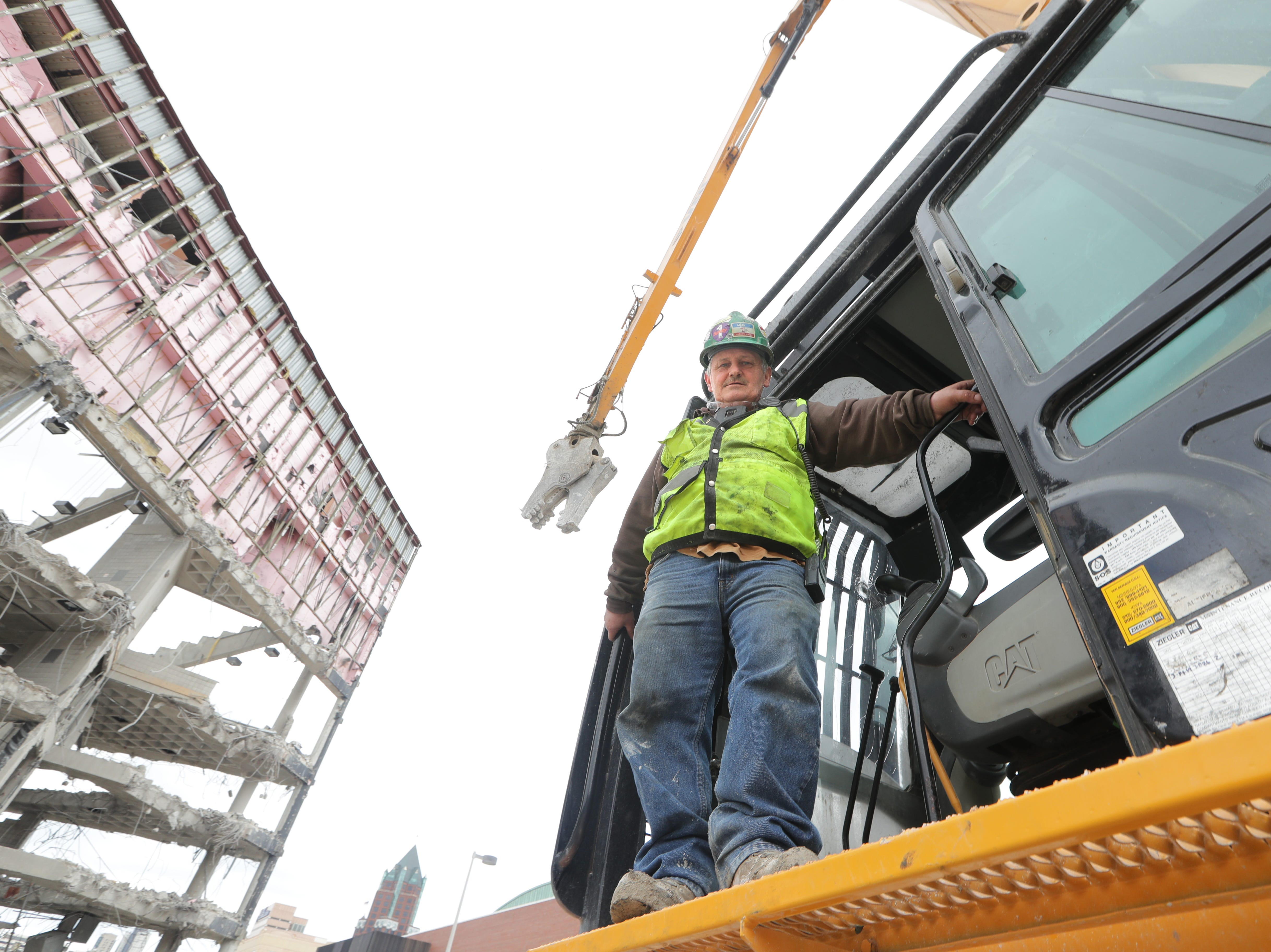 Joe McEwen, a demolition machine operator with Veit & Company, Inc. operates the high reach demolition excavatorbeing used to take down the BMO Harris Bradley Center, where the Milwaukee Bucks used to play, in Milwaukee on Thursday, May 9, 2019.