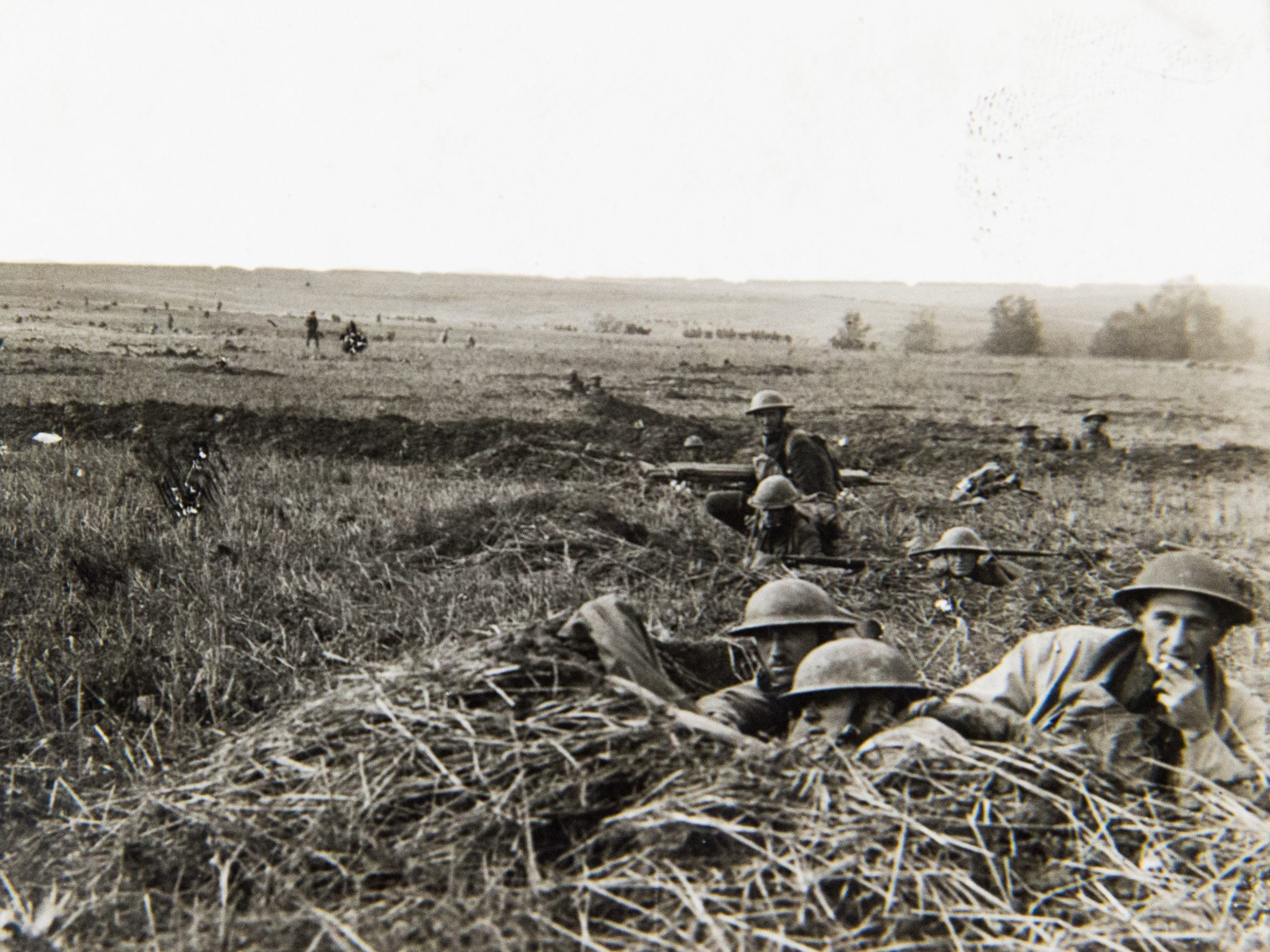 Troops of the 64th Infantry Brigade, 32nd Division, advancing while in support of the first line near Romagne-Sous-Montfaucon, Meuse, France. Photo taken Oct. 18, 1918.