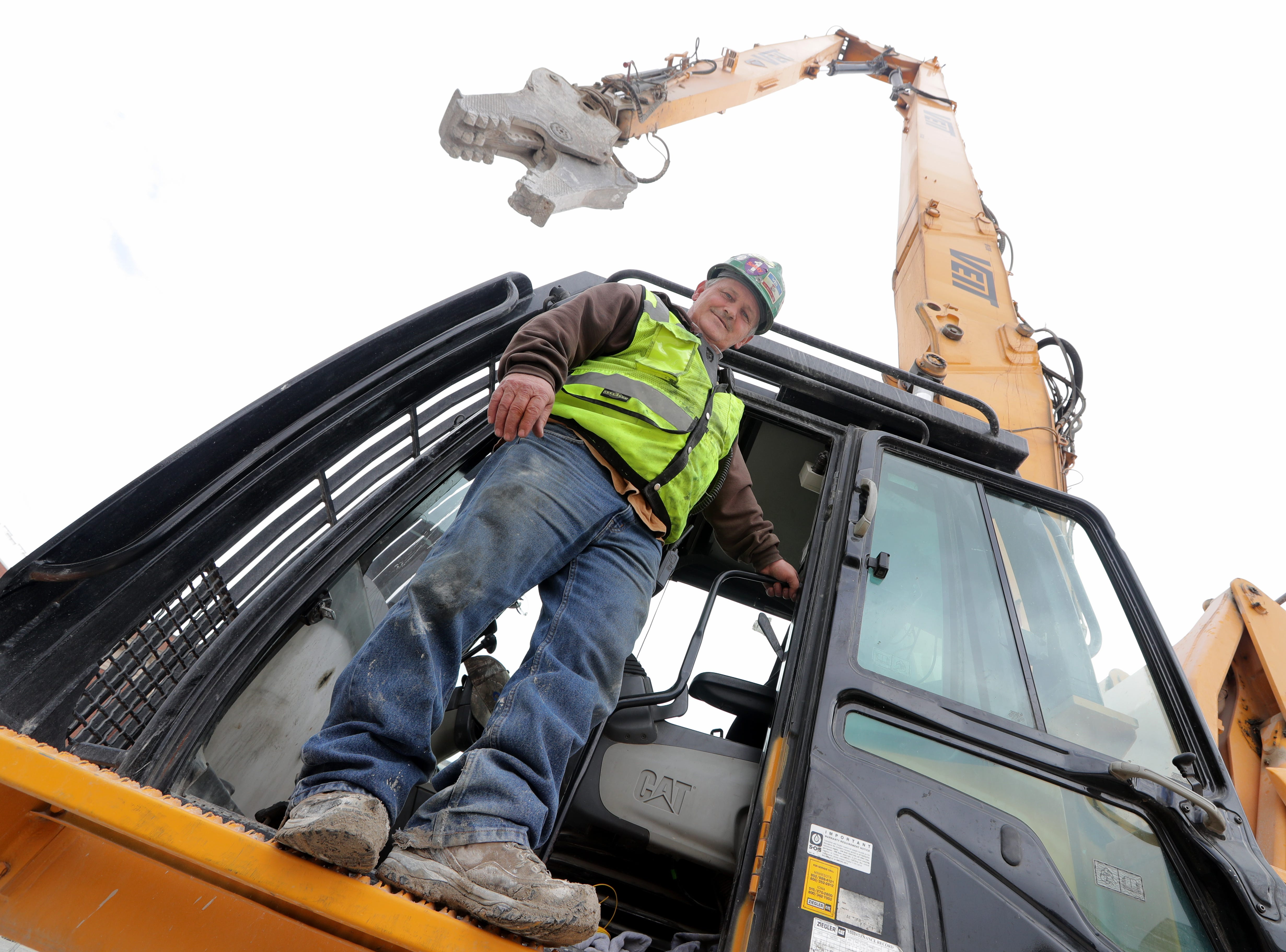 Joe McEwen, a demolition machine operator with Veit & Company, Inc. operates the high reach demolition excavatorbeing used to take down the BMO Harris Bradley Center, where the Milwaukee Bucks used to play, in Milwaukee.