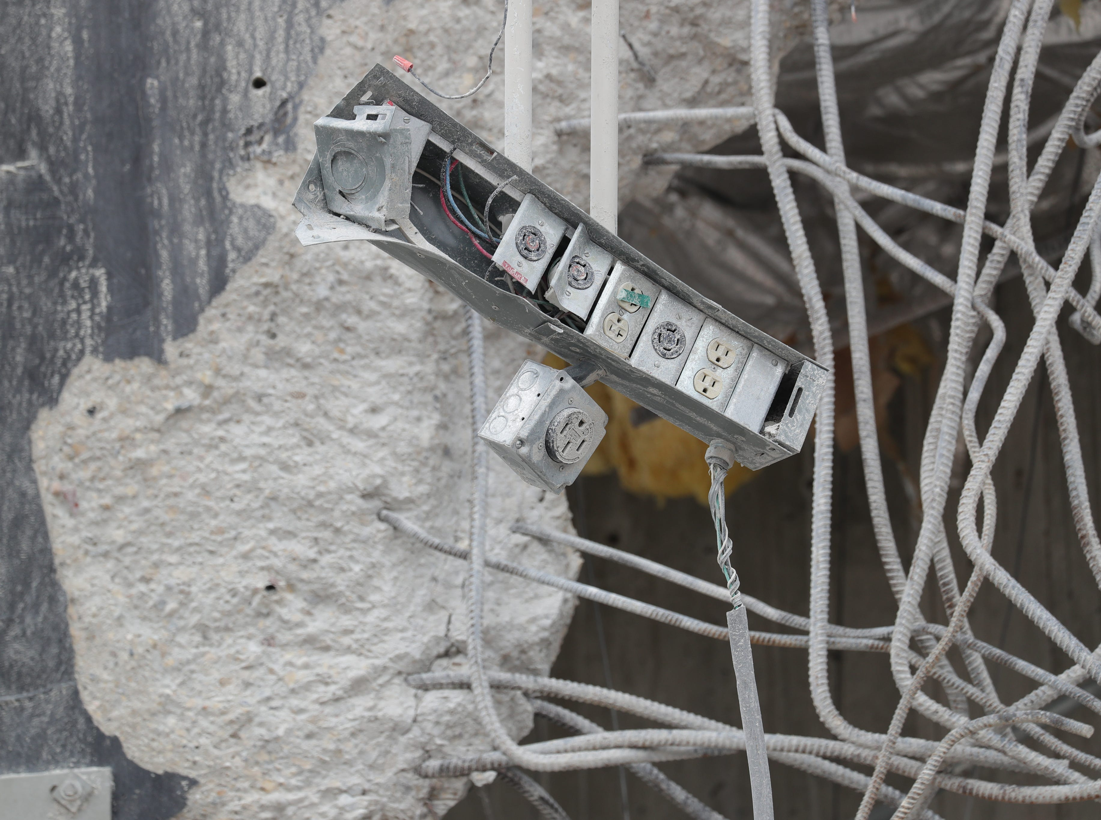 A series of power outlets are dangling in the BMO Harris Bradley Center being demolished, where the Milwaukee Bucks used to play,