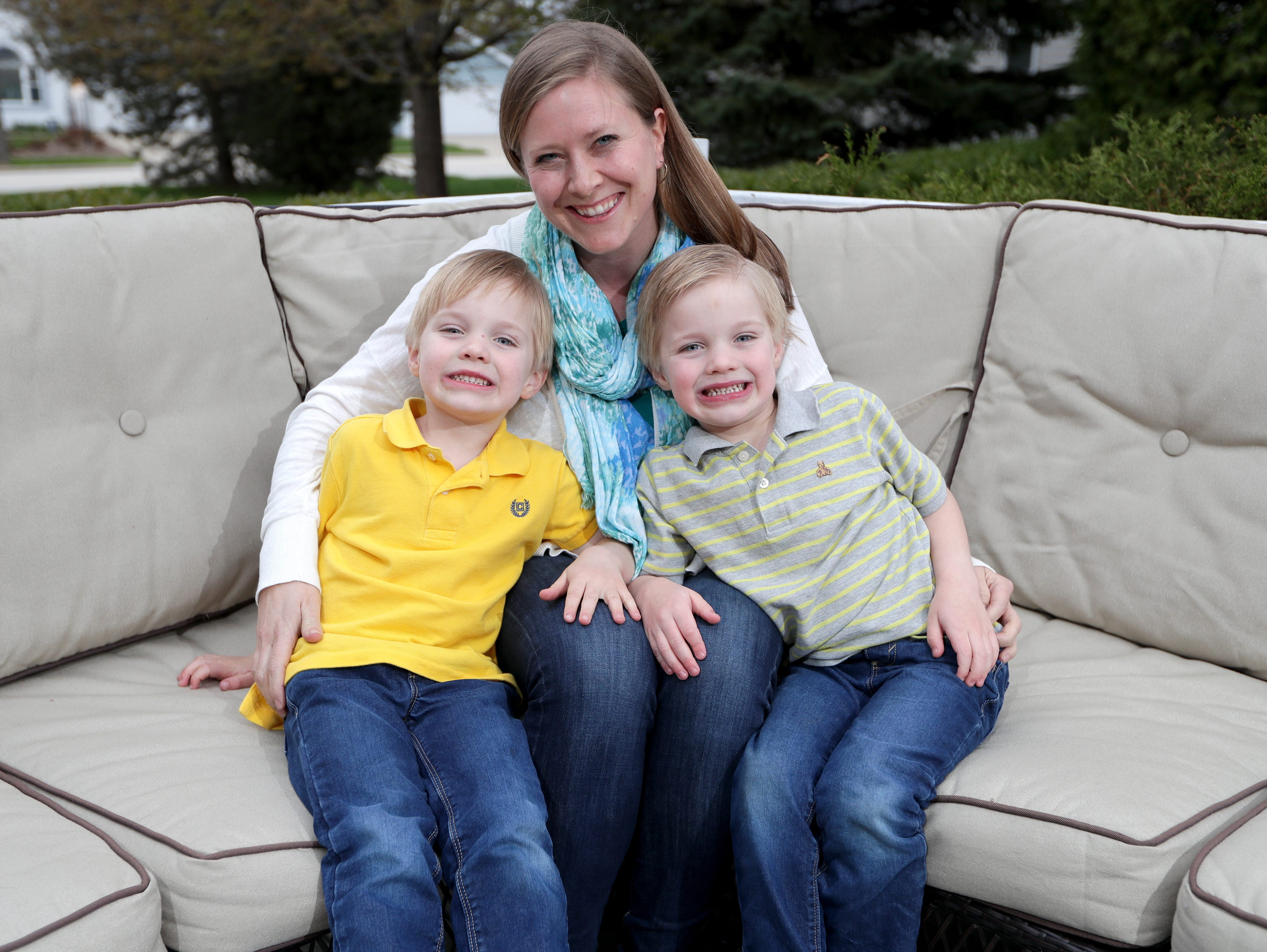 Hayley Schuster of Bayside, with her identical twins, Charlie, left, and Jack.