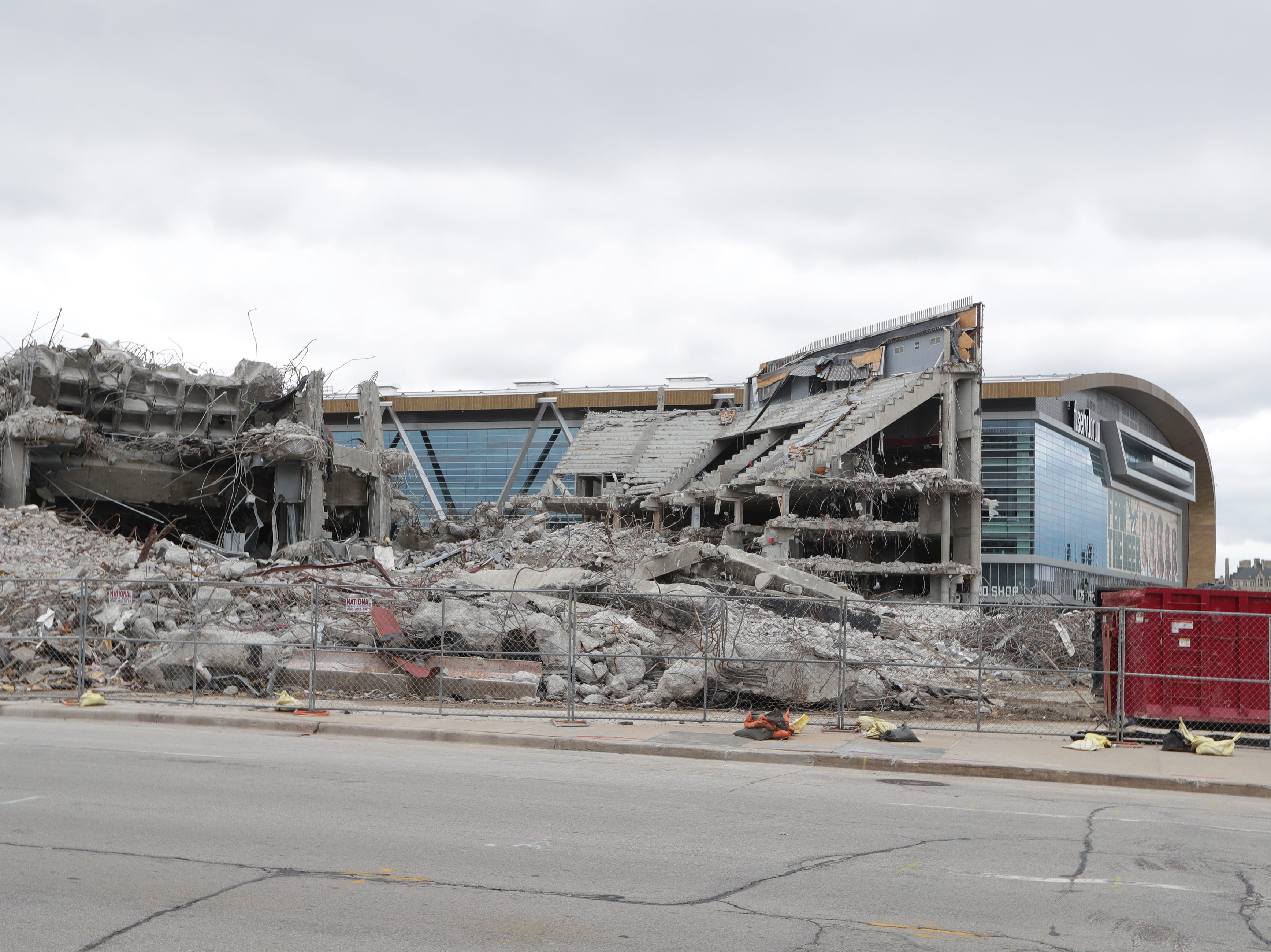 The BMO Harris Bradley Center being demolished, where the Milwaukee Bucks used to play, sets next to the new Fiserv Forum in Milwaukee on Thursday, May 9, 2019.