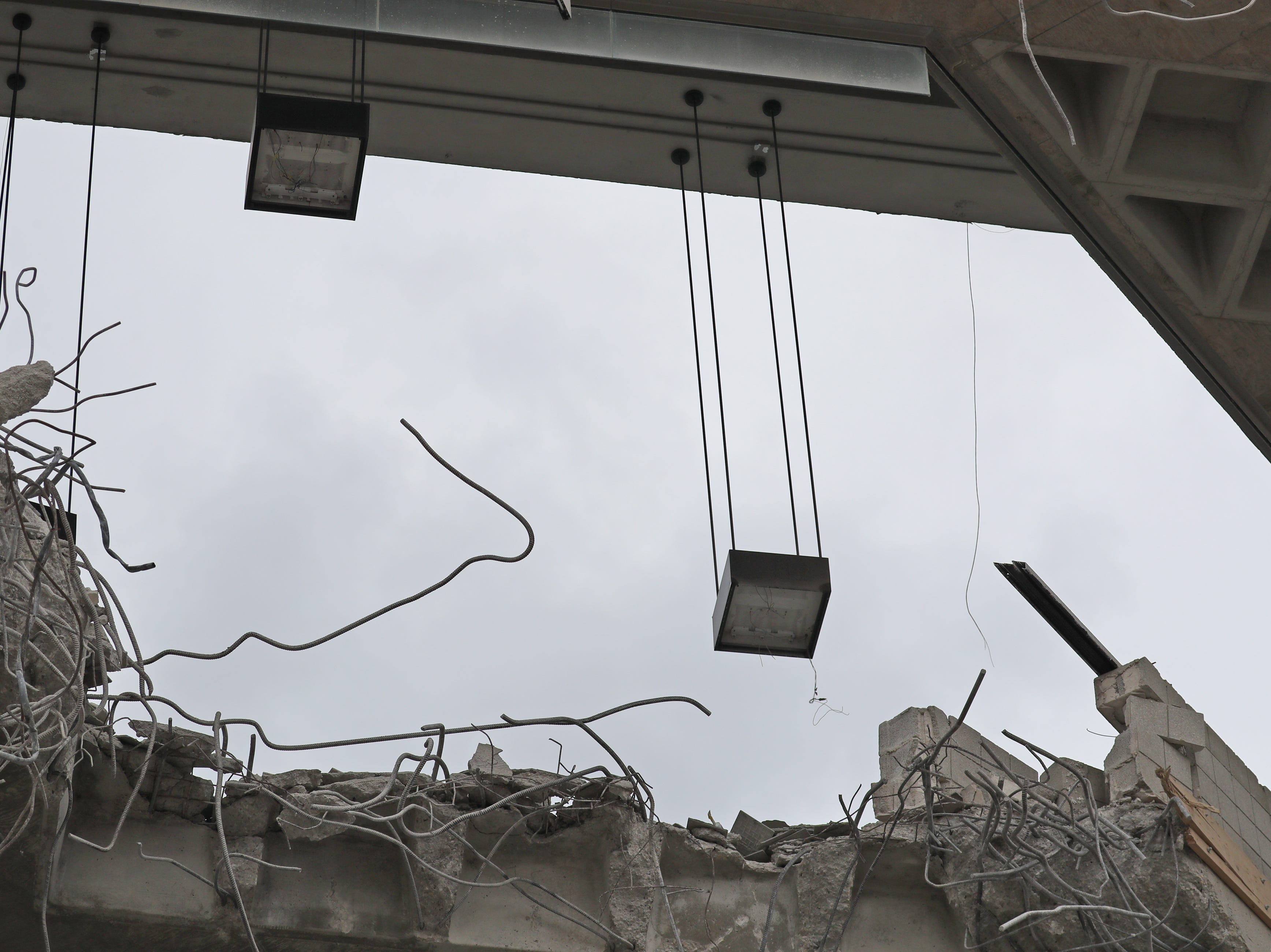 Overhead lighting are dangling in the BMO Harris Bradley Center being demolished,