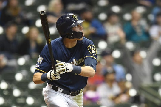 Christian Yelich of the Milwaukee Brewers hits a solo home run during the eighth inning against the St. Louis Cardinals at Miller Park, April 15, 2019, in Milwaukee.