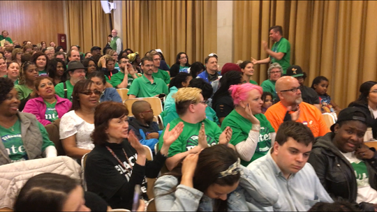 """Members of the Milwaukee Teachers' Education Association and supporters chant """"If we don't get it, shut it down"""" before a public hearing on Milwaukee Public Schools' 2019-20 budget Thursday night."""