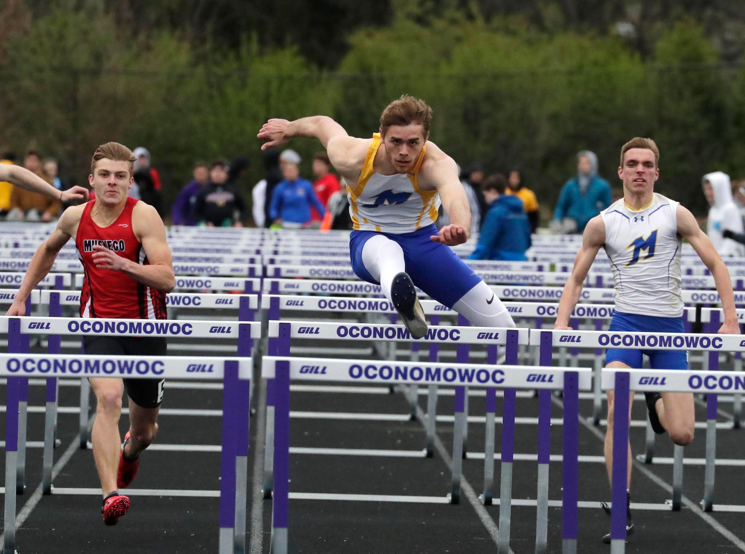 Wesley Juszczak of Mukwonago wins the Boys 110-meter hurdles finals with a time of 15.34 seconds beating Muskego's Spencer Reichart (15.73) during the Classic 8 Conference track meet in Oconomowoc, Thursday, May 9, 2019.
