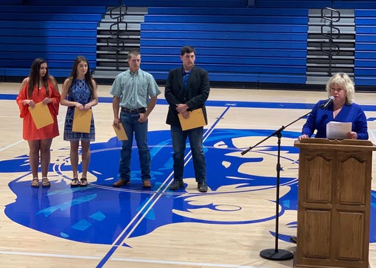 "The Cotter Warrior Foundation recently awarded seven scholarships to members of the Cotter High School Class of 2019. The recipients are: (from left) Averee Hutson, Jordan Francis, Kevin Walker and Jarod Dewey. Also pictured is founding Board Member and Cotter High School English teacher Sandy Wilhite (far right), who presented the scholarships. The scholarships awarded were: Three ""John A. and Dorothy L. (Scottie) Reeves and Michael A. Reeves Memorial Scholarships"" in the amount of $1,000 each to Hutson, Dewey and Walker. Two ""Cotter Warrior Foundation Scholarships"" in the amount of $1,000 each to Hutson and Dewey. The ""Sam Roth Memorial Scholarship"" in the amount of $1,000 was awarded to Class of 2019 Valedictorian Jordan Francis, as was the first annual ""Judy Nazarenko Memorial Scholarship"" in the amount of $500."