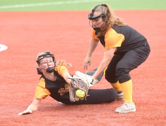Salem's Allyson Walsh dives for the ball as teammate Nicole McGill backs her up during the Lady Greyhounds' 9-7 win over Hackett on Thursday.