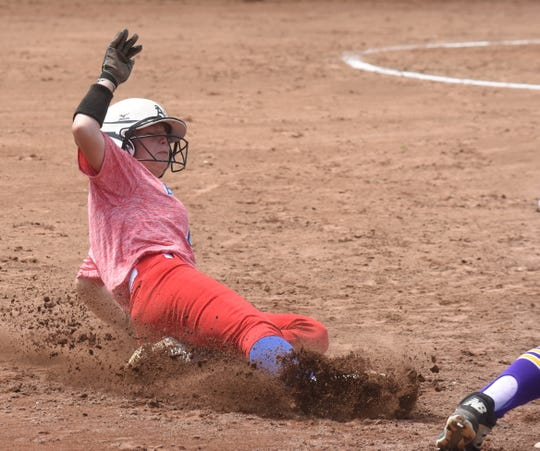 Melbourne's Kate Provence slides into third base on Thursday against Lavaca.