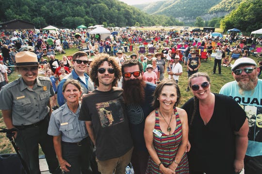 Members of the band National Park Radio pose with National Park Service staff, Buffalo National River Partners president Ginger Milan and more than 1,000 concertgoers at 2018's show.
