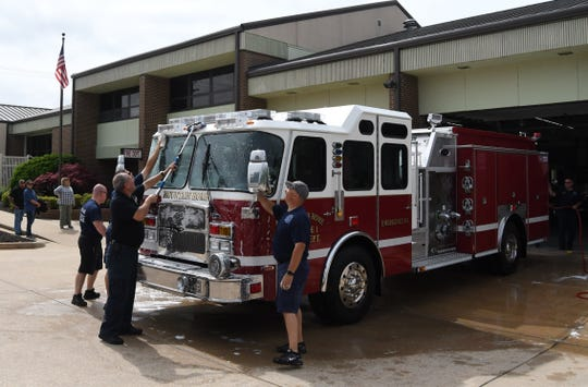 Mountain Home firefighters give the city's new Engine No. 1, a 2019 E-One Typhoon, a bath Thursday morning.