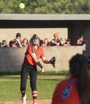 Viola's Keyaira Moore throws to first for an out during a recent game.