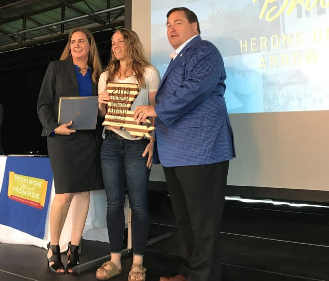 Brooke Foy, center, received the Julia Trichell Award from Monroe-West Monroe Convention and Visitors Bureau President Alana Cooper and Lt. Gov. Billy Nungesser.