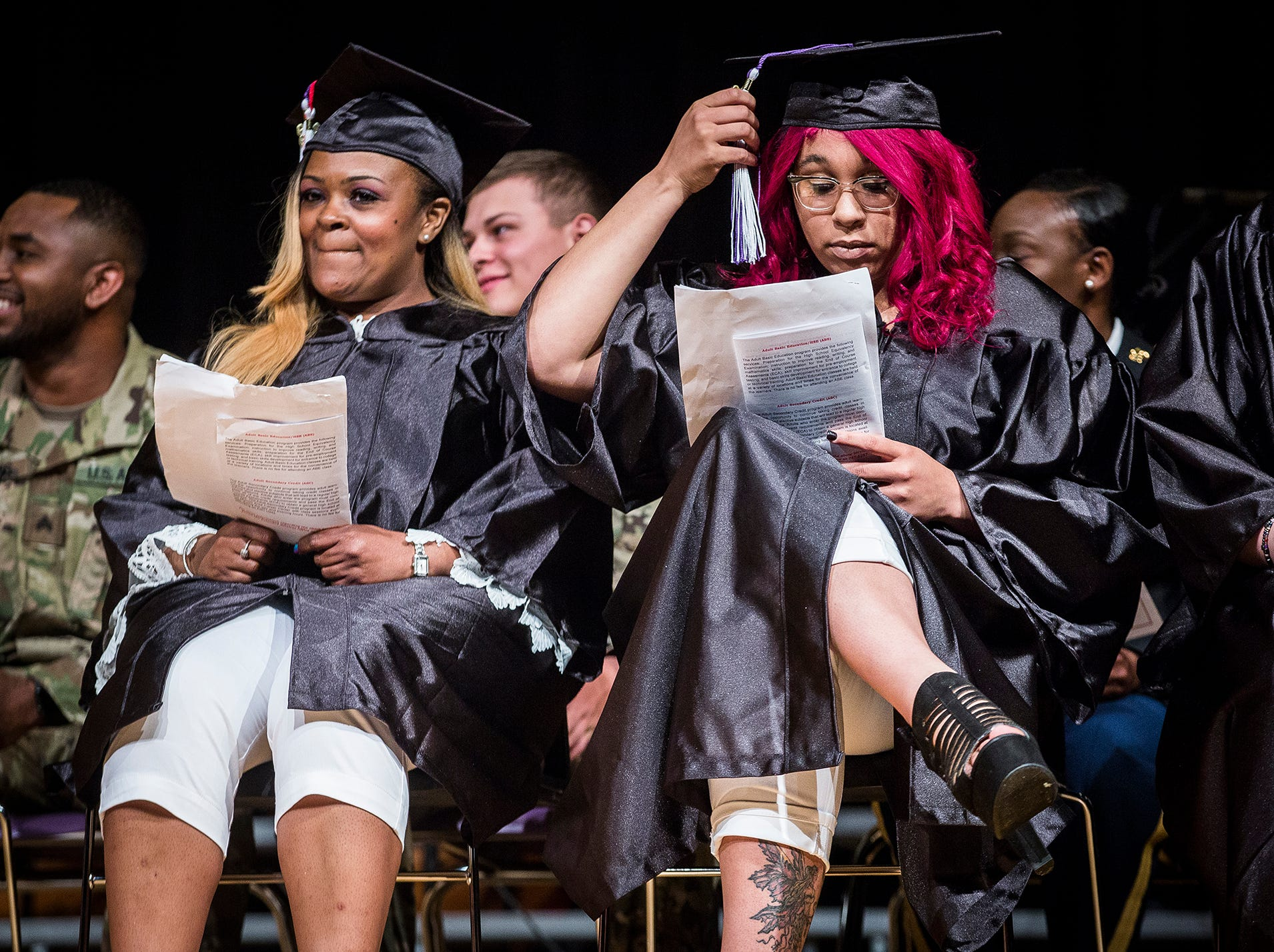 Angela Bennett and Karmen Lykins prepare for their speeches during the 2019 MCS Adult Education Program graduation ceremony at Central Thursday night.