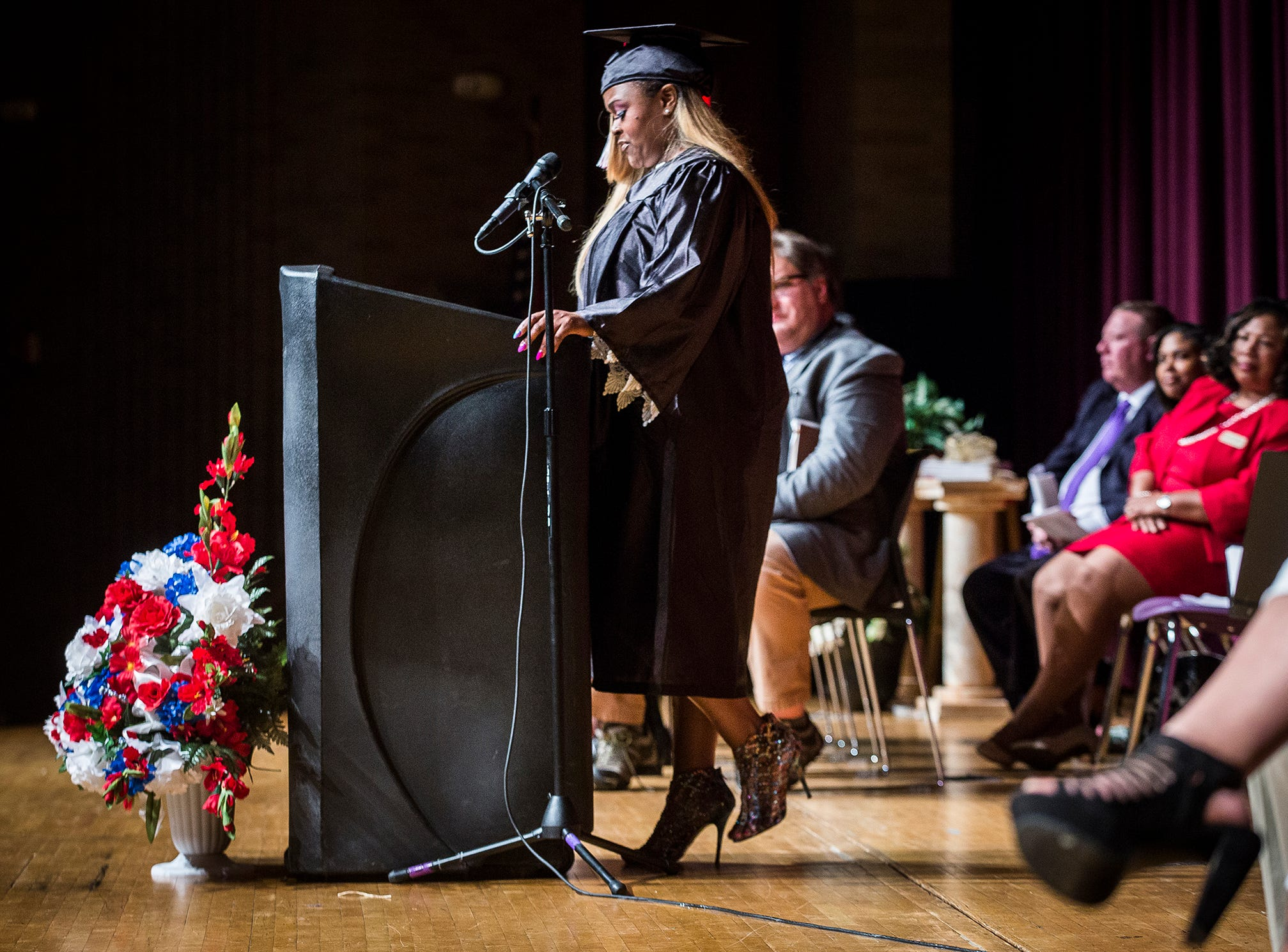 Angela Bennett speaks to attendees about overcoming addiction and other hurdles before receiving her high school diploma during the 2019 MCS Adult Education Program graduation ceremony at Central Thursday night.
