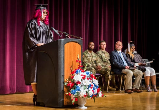 Karmen Lykins speaks to attendees during the 2019 MCS Adult Education Program graduation ceremony at Central Thursday night.