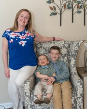 "The Tennessee Justice Center is honoring Shannon Grimes as a 2019 Mother of the Year for her determination to get her son, Carson, middle, the care that he needs, as well as her drive to advocate for kids with disabilities across Tennessee. She said her son, Tanner, right, is a ""rock star"" when it comes to helping with his brother."