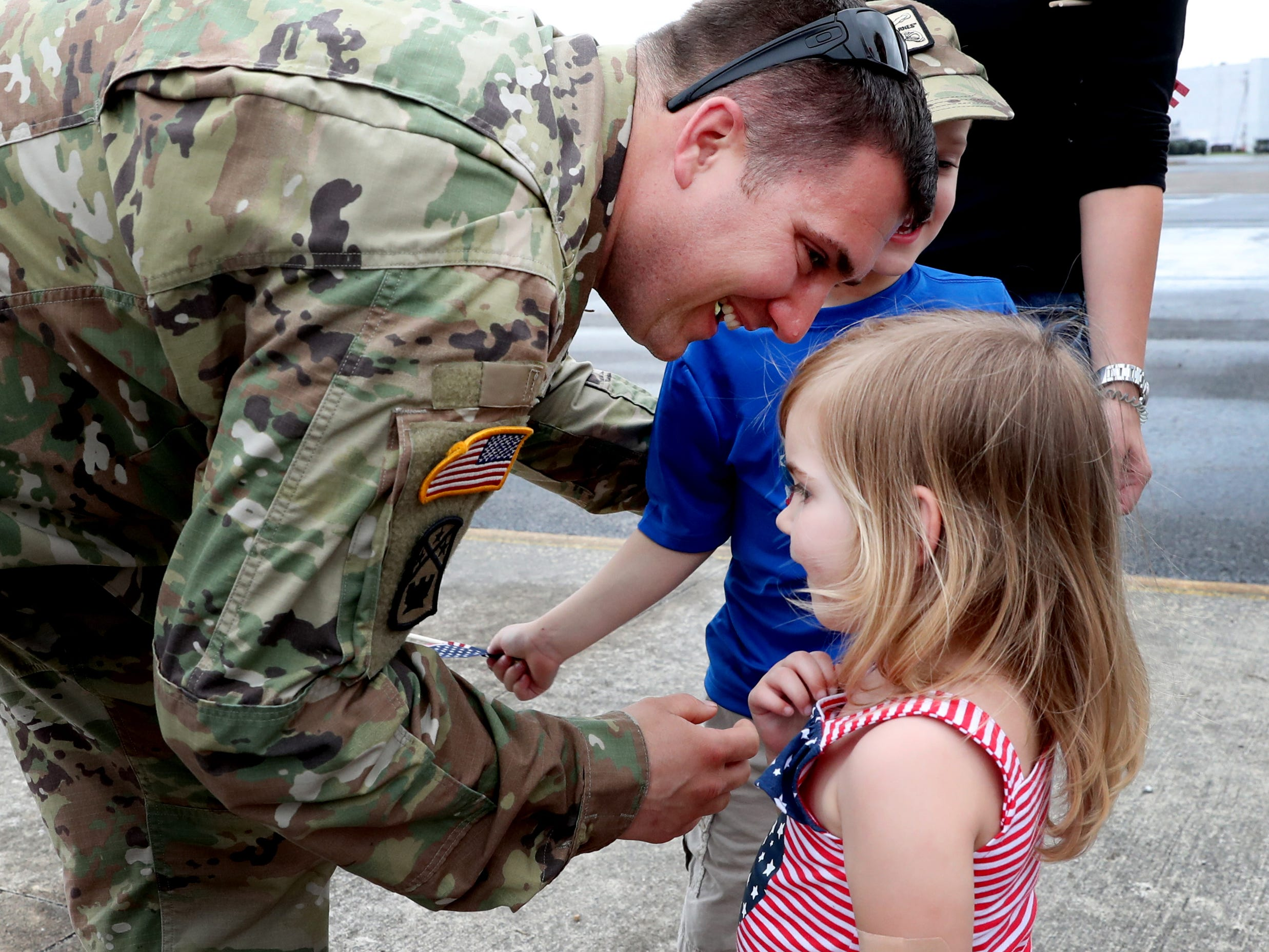 Sgt. Jake Baker with the 278th ACR, greets his 2 year-old daughter Deeley Baker after he got off a plane, at the Volunteer Training Site in Smyrna, from a 9 month overseas deployment on Thursday, May 9, 2019.