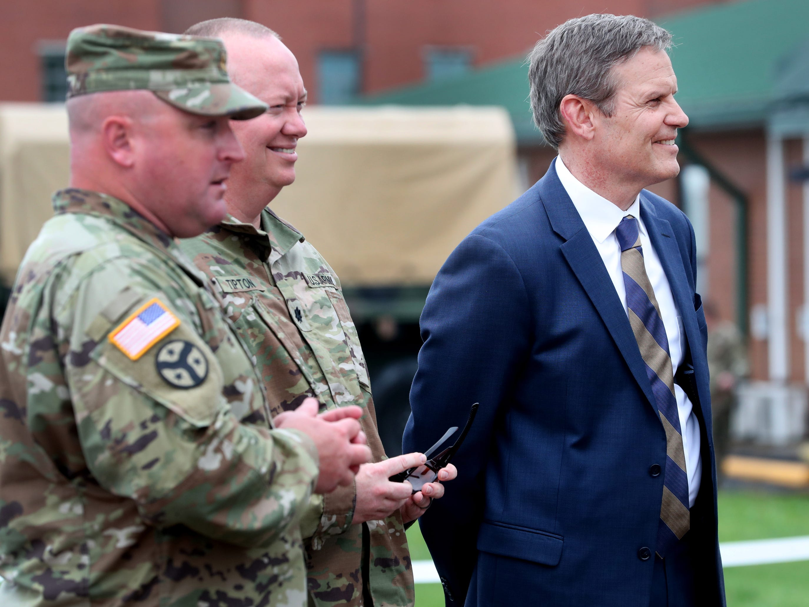 Tennessee Governor Bill Lee waits to talk to the returning troops with the 278th ACR after their plane landed at the Volunteer Training Site in Smyrna, Tennessee on Thursday, May 9, 2019 after they served a 9 month overseas deployment.