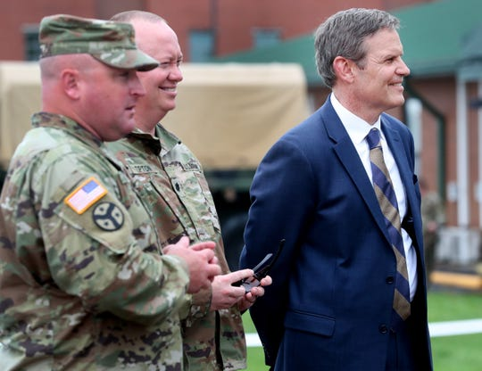 Tennessee Gov. Bill Lee waits to talk to the returning troops with the 278th ACR after their plane landed in Smyrnaon Thursday, after they served a nine-month overseas deployment.