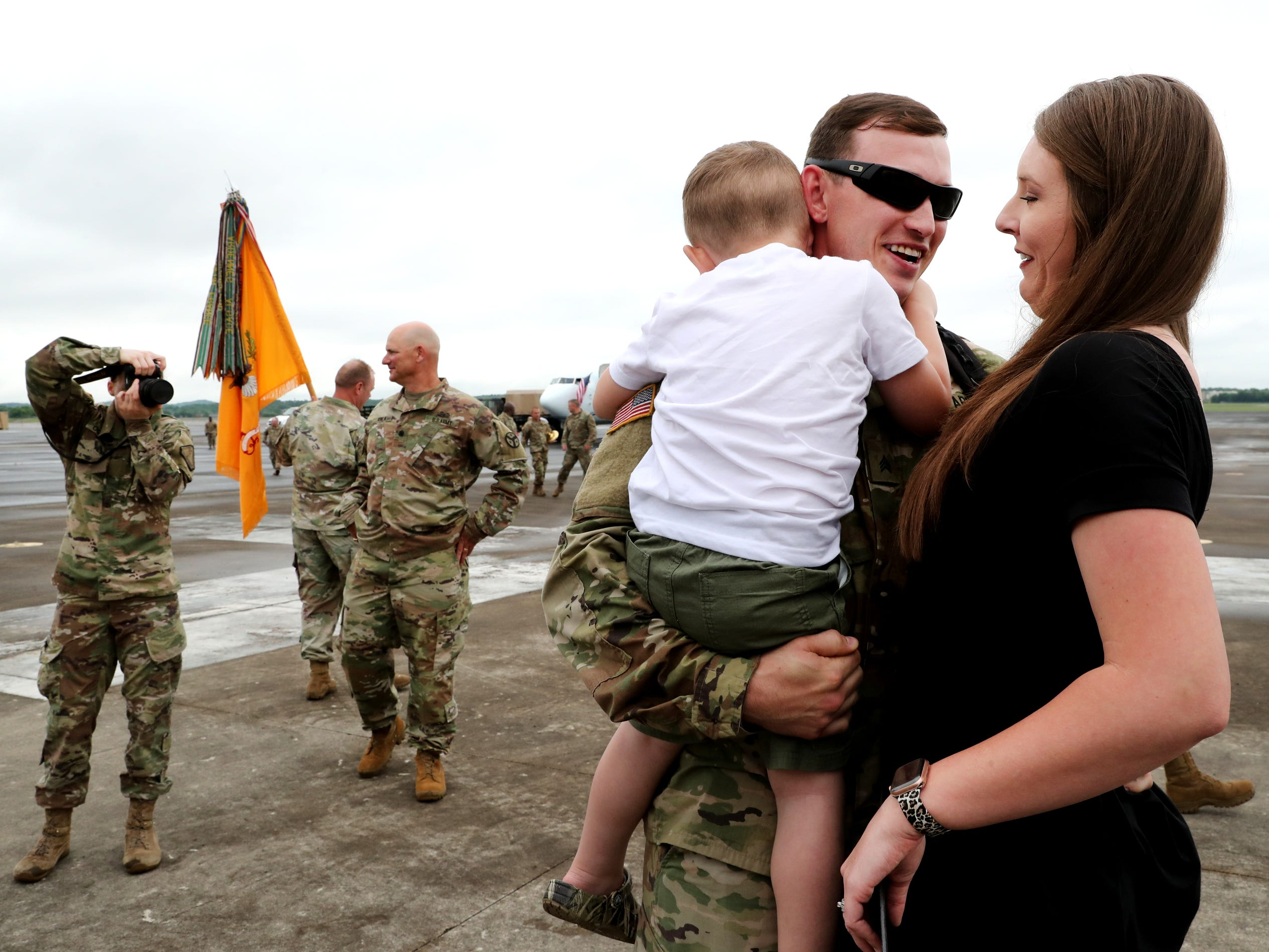 Sgt. Cody Chipman, with the 278th ACR holds his son Camden Chipman, 3 and greets his wife Kristin Chipman as he returns to the Volunteer Training Site in Smyrna, after a 9 month overseas deployment on Thursday, May 9, 2019.