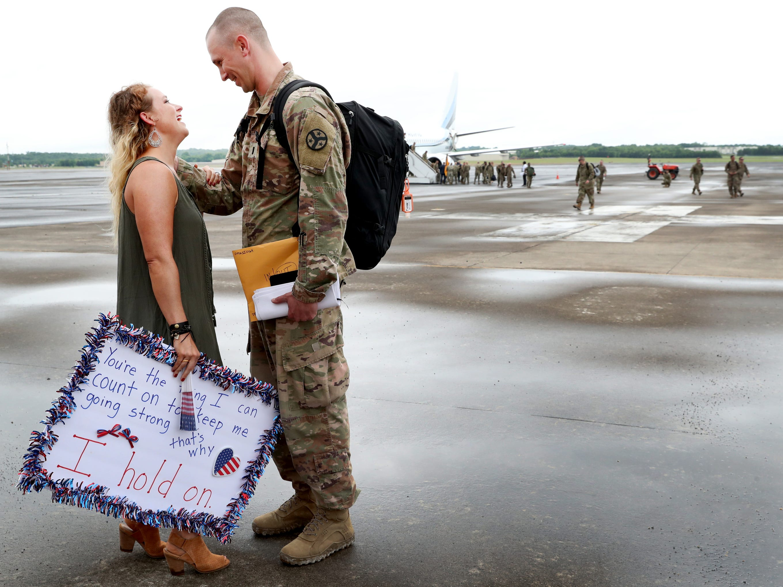 Kristy Bobo meets her husband Derek Bobo, with the 278th ACR after he gets off the plane at the Volunteer Training Site in Smyrna, from a 9 month overseas deployment on Thursday, May 9, 2019.