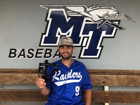 MTSU's Drew Huff holds up the mask he now has to wear when he pitches after suffering a scary facial injury back in early April.