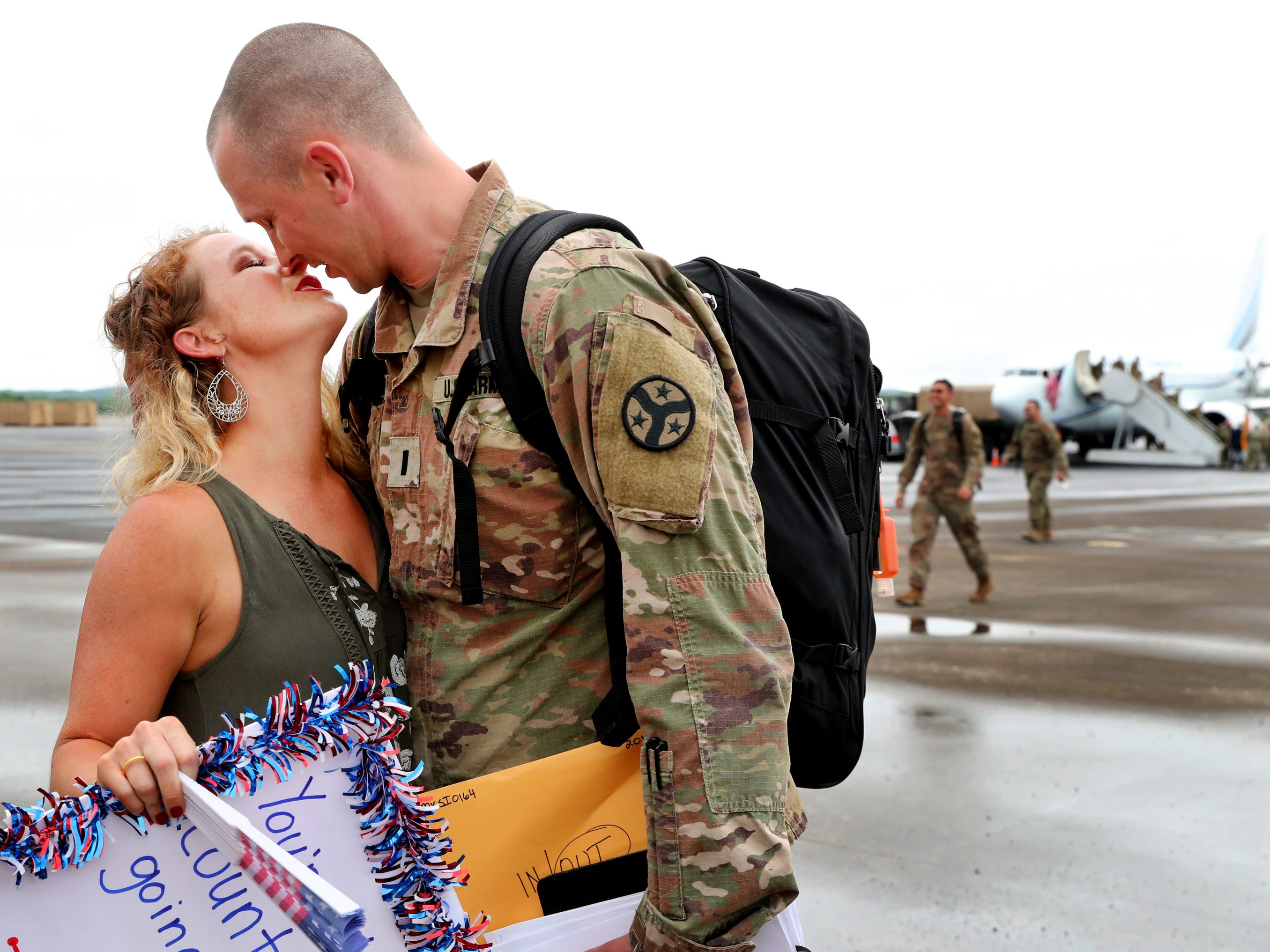 Kristy Bobo kisses her husband Derek Bobo, with the 278th ACR after he gets off the plane at the Volunteer Training Site in Smyrna, from a 9 month overseas deployment on Thursday, May 9, 2019.