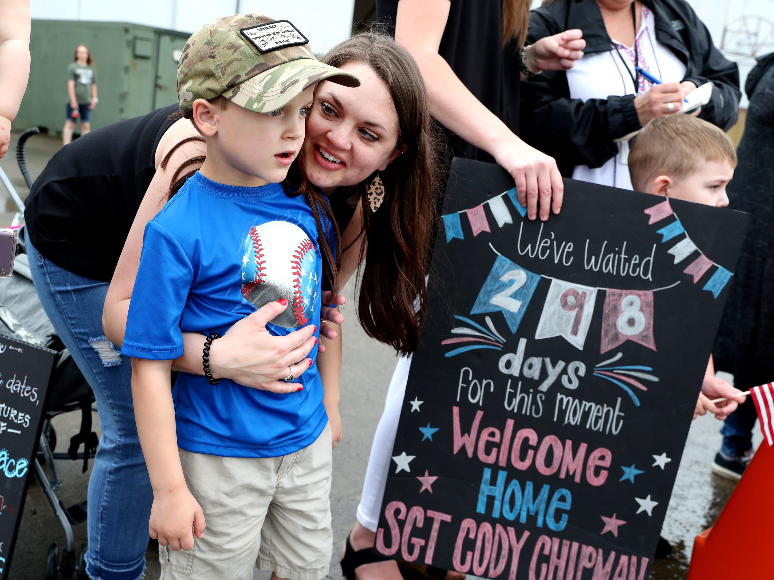 Molly Baker and her son Whitt Baker, 5, wait for Sgt. Jake Baker their husband and father to return with the 278th ACR, at the Volunteer Training Site in Smyrna, from a 9 month overseas deployment  on Thursday, May 9, 2019.