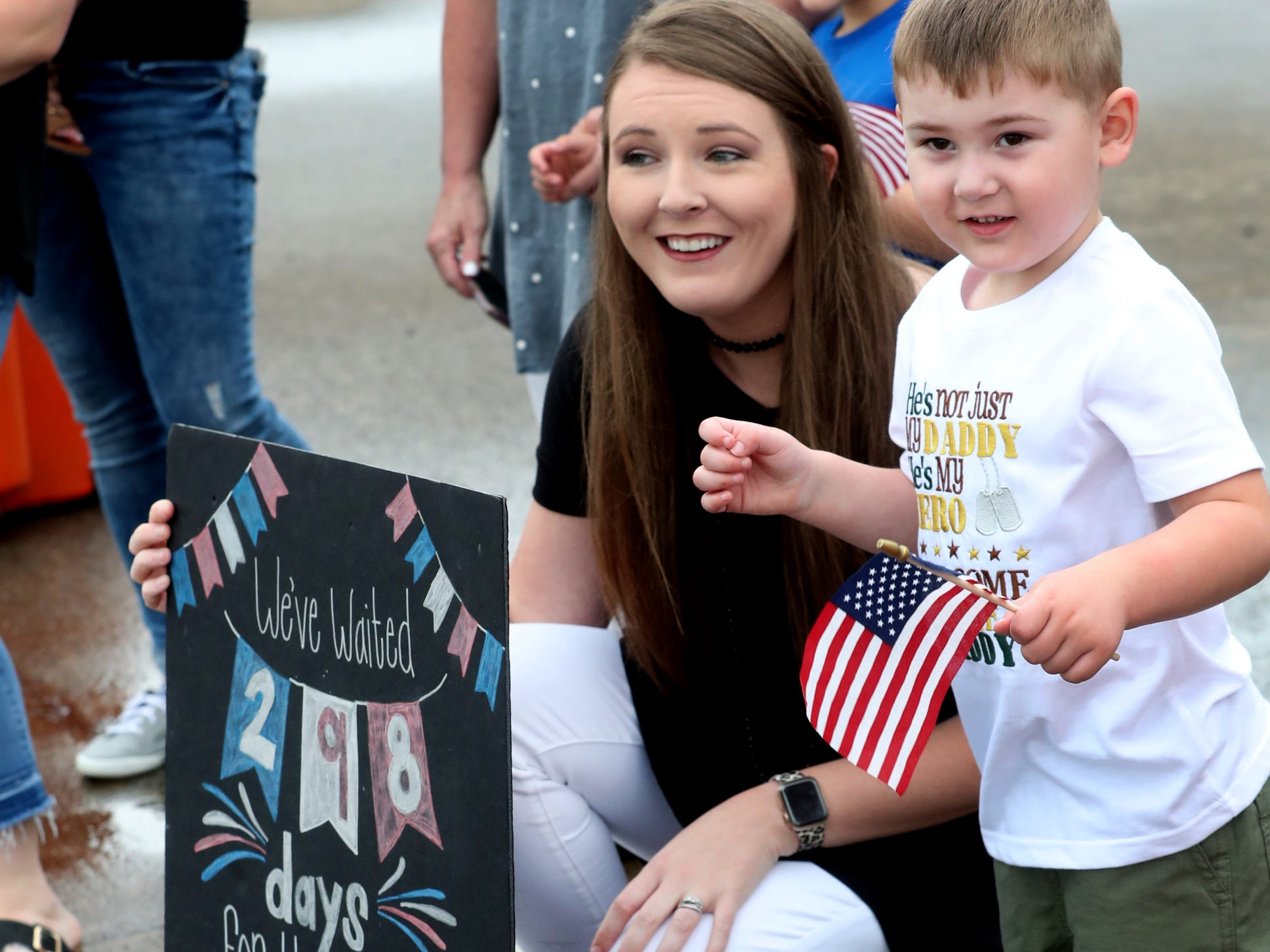Kristin Chipman and her son Camden Chipman wait for her husband and his father Sgt. Cody Chipman with the 278th ACR, to return to the Volunteer Training Site in Smyrna, from a 9 month overseas deployment  on Thursday, May 9, 2019.