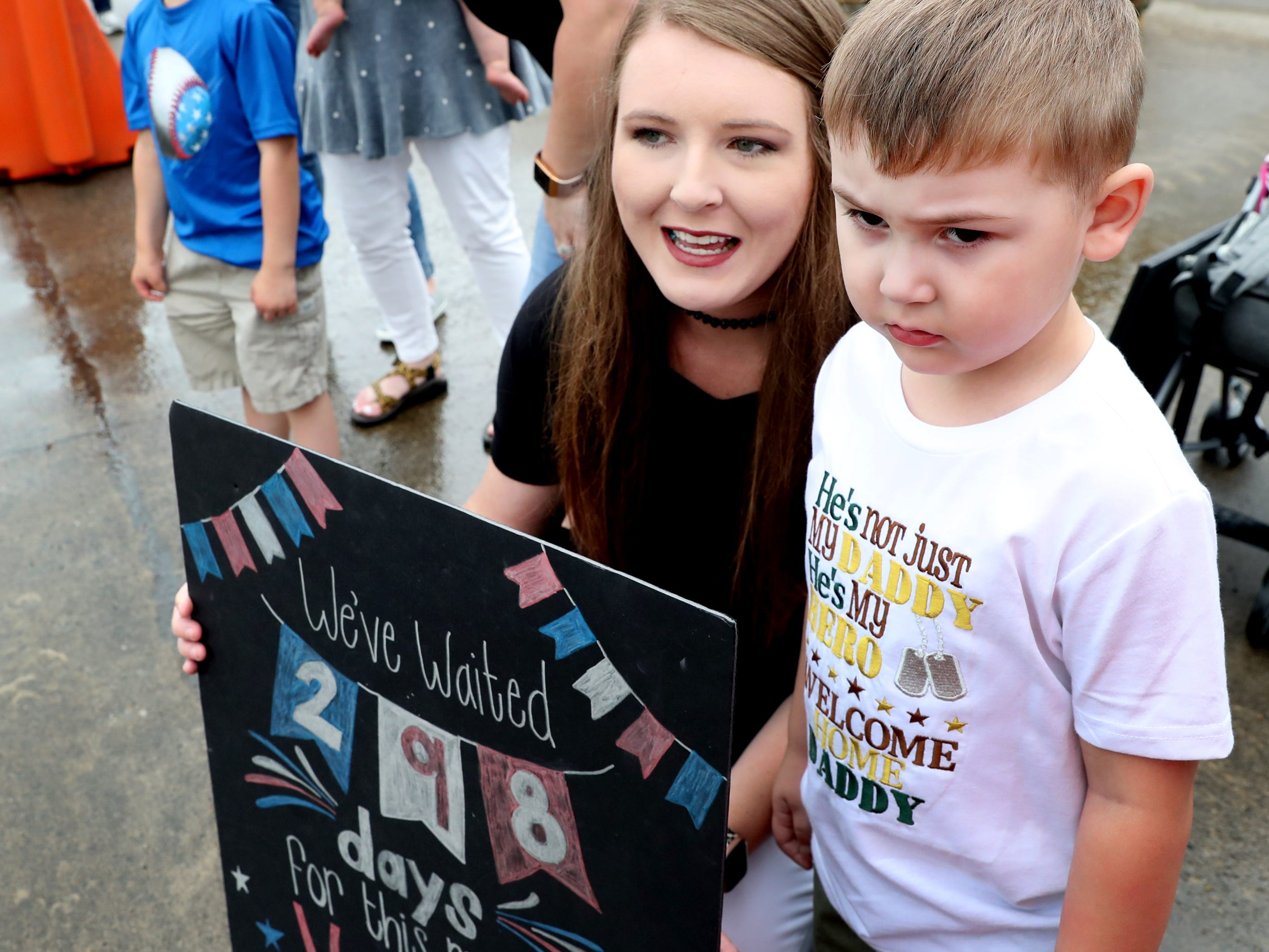 Kristin Chipman and her son Camden Chipman wait for her husband and his father, Sgt. Cody Chipman with the 278th ACR, to return to the Volunteer Training Site in Smyrna, from a 9 month overseas deployment on Thursday, May 9, 2019.